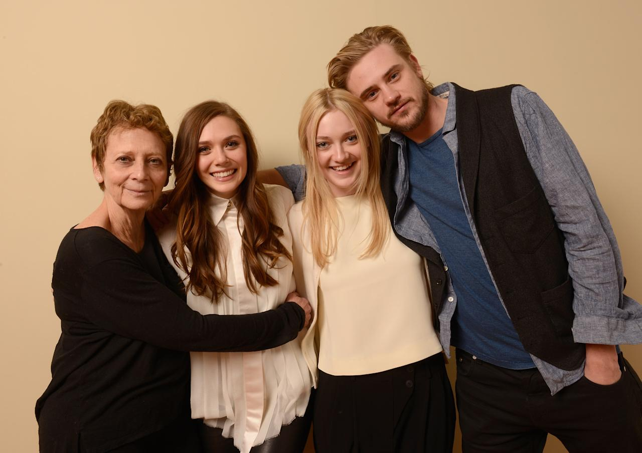 PARK CITY, UT - JANUARY 23:  (L-R) Director/writer Naomi Foner, and actors Dakota Fanning, Elizabeth Olsen and Boyd Holbrook pose for a portrait during the 2013 Sundance Film Festival at the Getty Images Portrait Studio at Village At The Lift on January 23, 2013 in Park City, Utah.  (Photo by Larry Busacca/Getty Images)