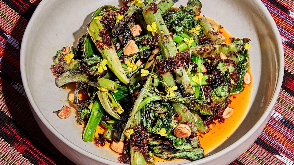 "If you can't find yu choy, a slightly bitter green in the brassica family that's often available at Asian markets, don't be discouraged: The fiery sate oil complements any grilled vegetable. <a href=""https://www.bonappetit.com/recipe/grilled-yu-choy-with-sate-oil?mbid=synd_yahoo_rss"" rel=""nofollow noopener"" target=""_blank"" data-ylk=""slk:See recipe."" class=""link rapid-noclick-resp"">See recipe.</a>"