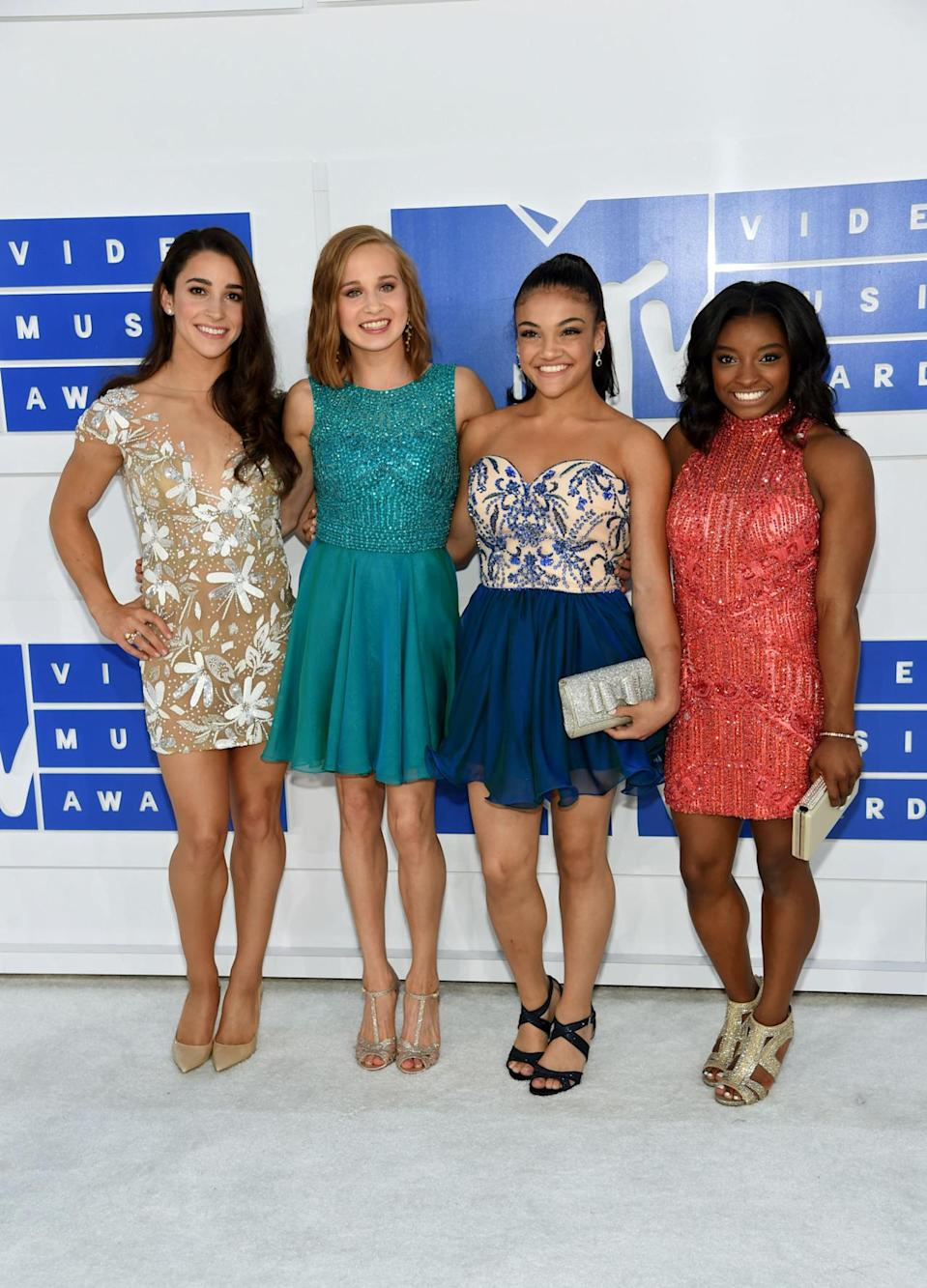 <p>Just days after rocking Rio, the Final Five (minus one, Gabby Douglas was hospitalized over the weekend — don't worry, she's OK) walked the red carpet together in dresses. Ditching their leotards and patriotic makeup, the crew looked amazing in sparkly ensembles. <i>(Photo: Getty Images)</i></p>