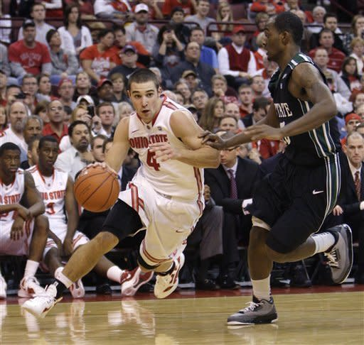 Ohio State's Aaron Craft, left, drives the baseline against South Carolina Upstate's Adrian Rodger during the second half of an NCAA college basketball game Wednesday, Dec. 14, 2011, in Columbus, Ohio. Ohio State beat South Carolina Upstate 82-58. (AP Photo/Jay LaPrete)
