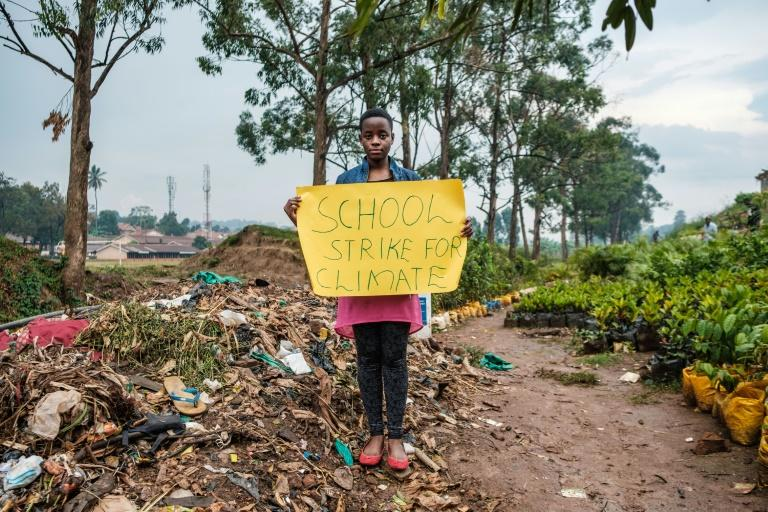 Taking her cue from Swedish climate campaigner Greta Thunberg, Leah Namugerwa is leading green activism in Uganda, with her efforts already earning her a human rights award from Amnesty International (AFP Photo/SUMY SADURNI)