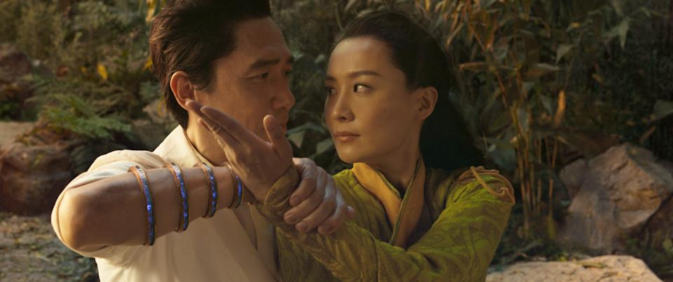 """Wenwu (Tony Leung) and Li (Fala Chen) fall in love during a martial-arts sequence in """"Shang-Chi."""""""