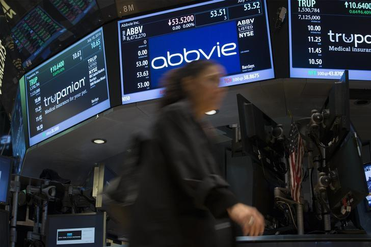 A screen displays the share price for pharmaceutical maker AbbVie on the floor of the New York Stock Exchange