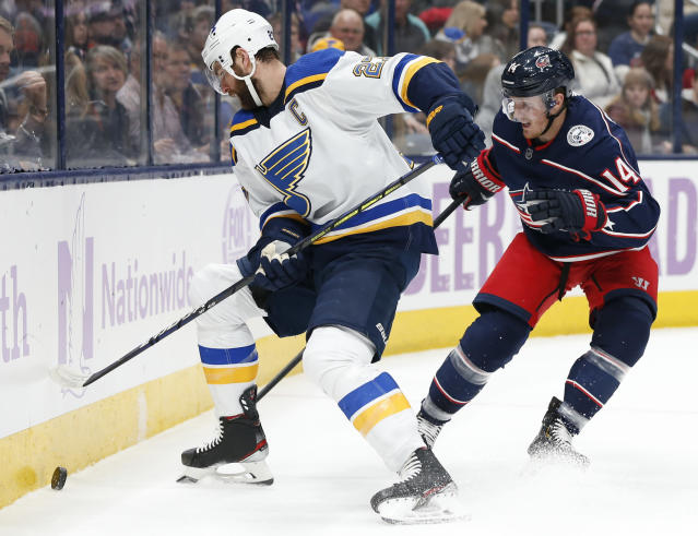 St. Louis Blues' Alex Pietrangelo, left, keeps the puck away from Columbus Blue Jackets' Gustav Nyquist, of Sweden, during the first period of an NHL hockey game Friday, Nov. 15, 2019, in Columbus, Ohio. (AP Photo/Jay LaPrete)