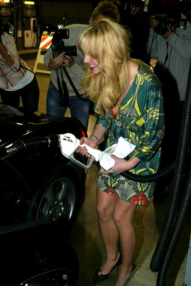 """A young Britney pumps gas in Malibu. Oh Britney, we miss your real hair! <a href=""""http://www.splashnewsonline.com"""" target=""""new"""">Splash News</a>"""
