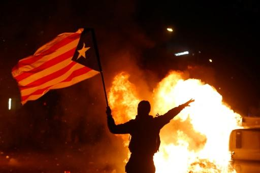 Many protesters were carrying Catalan separatist flags