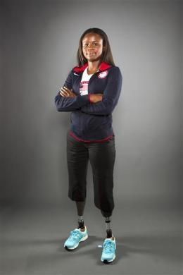 Paralympic sitting volleyball player Kari Miller poses for a portrait during the 2012 U.S. Olympic Team Media Summit in Dallas, May 15, 2012.