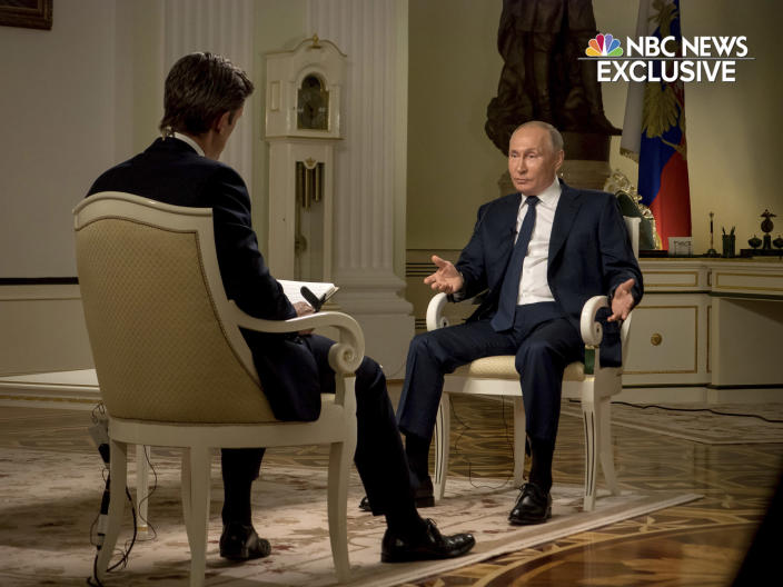 In this image provided by NBC News, journalist Keir Simmons, left, speaks with Russian President Vladimir Putin in an interview aired on Monday, June 14, 2021, two days before the Russian leader is to meet U.S. President Joe Biden in Geneva. Putin has sharply dismissed allegations that his country is carrying out cyberattacks against the United States as baseless. (NBC News via AP)