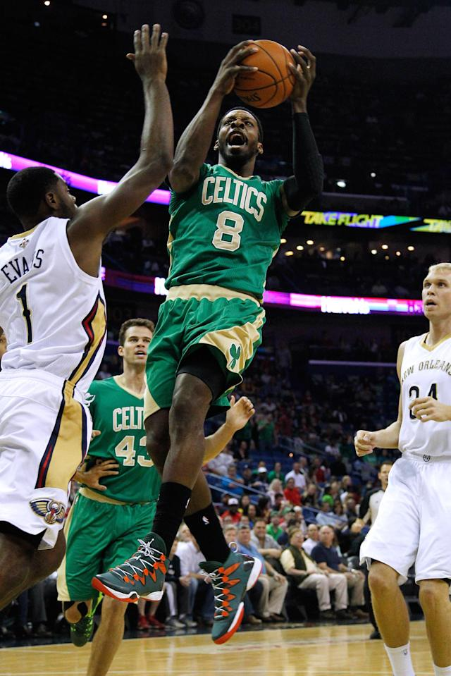 Boston Celtics forward Jeff Green (8) drives to the basket against New Orleans Pelicans forward Tyreke Evans (1) and New Orleans Pelicans center Greg Stiemsma, right, during the first half of an NBA basketball game in New Orleans, Sunday, March 16, 2014. (AP Photo/Jonathan Bachman)