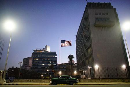 A vintage car passes by in front of the U.S. Embassy in Havana, Cuba, January 11, 2017. REUTERS/Alexandre Meneghini