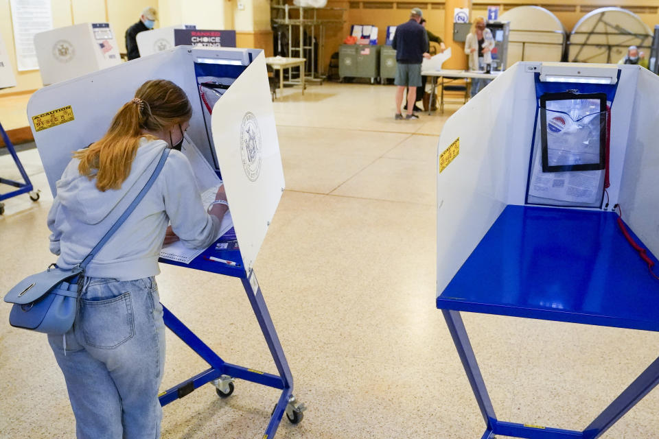 June Harkrider, who turned 18 in March, marks her ballot as she votes for the first time during early voting in the primary election, Monday, June 14, 2021, at the Church of St. Anthony of Padua in the Soho neighborhood of New York. (AP Photo/Mary Altaffer)