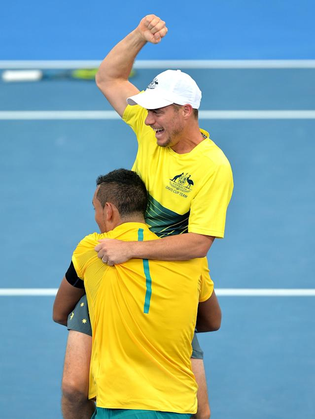 BRISBANE, AUSTRALIA - APRIL 09: Nick Kyrgios of Australia celebrates victory with Team Captain Lleyton Hewitt after his match against Sam Querrey of the USA during the Davis Cup World Group Quarterfinals between Australia and the USA at Pat Rafter Arena on April 9, 2017 in Brisbane, Australia. (Photo by Bradley Kanaris/Getty Images)