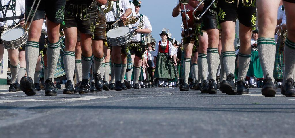 Members of a brass band wearing traditional Bavarian clothes participate in the riflemen's parade at Oktoberfest 2012 in Munich, Germany.