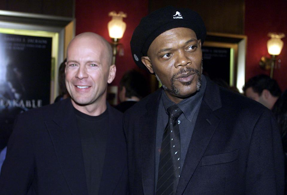 """Actors Bruce Willis (L), who plays David Dunn, and Samuel L. Jackson, who plays Elijah Price, arrive at the premier of Touchstone Pictures' """"Unbreakable"""" at the Ziegfield Theatre in New York City, November 14, 2000. The movie is scheduled to be released nationwide on November 22. BN/RCS"""