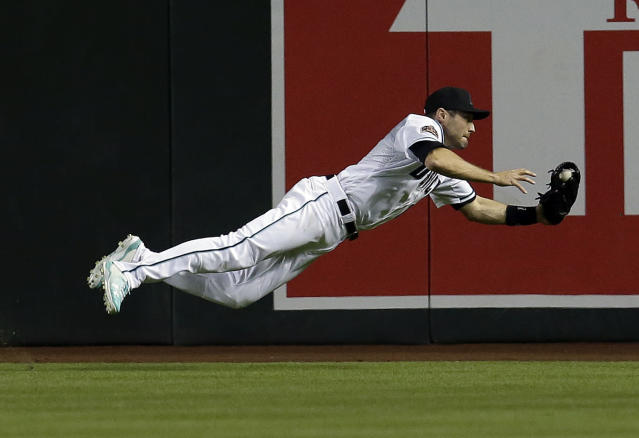 Arizona Diamondbacks right fielder David Peralta makes the diving catch in the seventh inning during a baseball game against the San Francisco Giants, Tuesday, April 17, 2018, in Phoenix. (AP Photo/Rick Scuteri)