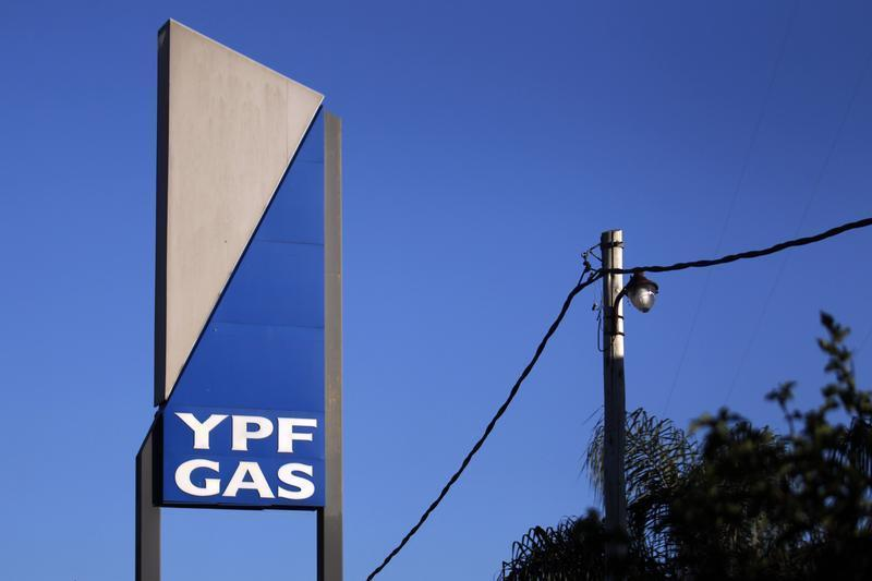 A sign with the YPF Gas logo is seen outside a gas distributor in Moreno