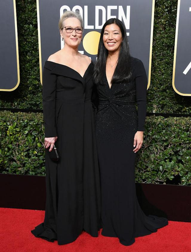 <p>Meryl Streep and activist Ai-jen Poo, who is director of the National Domestic Workers Alliance and co-director of the Caring Across Generations campaign, attend the 75th Annual Golden Globe Awards at the Beverly Hilton Hotel in Beverly Hills, Calif., on Jan. 7, 2018. Streep is nominated for <em>The Post</em>. (Photo: Steve Granitz/WireImage) </p>
