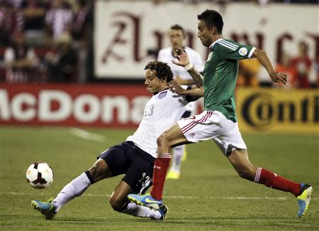United States' Jermaine Jones (13) fights for the ball with Mexico's Jesus Zavala (17) during the first half of their 2014 World Cup qualifying soccer match in Columbus, Ohio September 10, 2013. REUTERS/Matt Sullivan