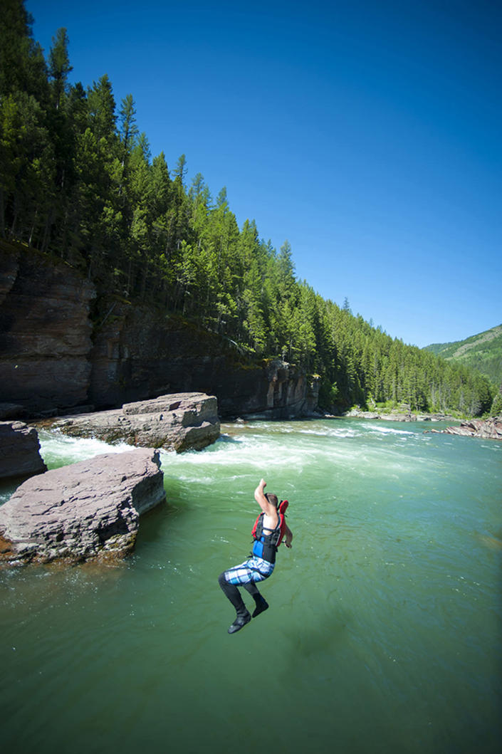 <p>Going for a swim in the Middle Fork of the Flathead River. (Photo: Lee Cohen) </p>