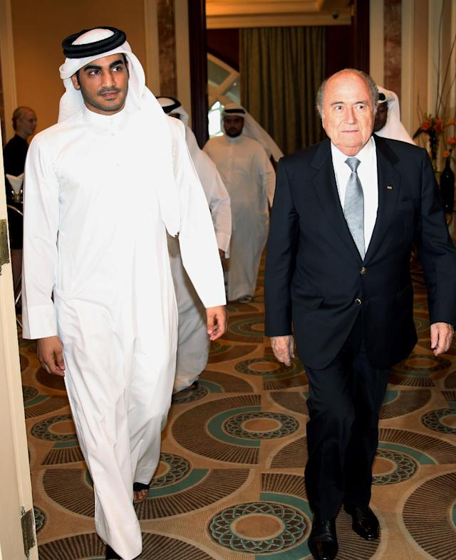 FIFA President Sepp Blatter, right, arrives with Sheik Mohammed bin Hamad al-Thani, chairman of Qatar 2022 bid committee, at a press conference in Doha, Qatar, Saturday, Nov. 9, 2013. Blatter said he is confident of resolving all issues with the 2022 World Cup in Qatar that has come under criticism by rights groups over conditions for workers building the venues. (AP Photo/Osama Faisal)