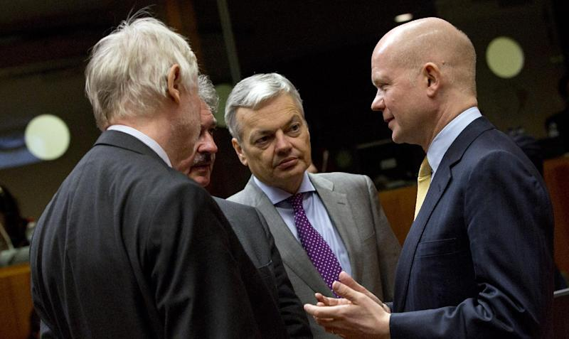 British Foreign Minister William Hague, right, speaks with from left, Finnish Foreign Minister Erkki Tuomioja, Luxembourg's Foreign Minister Jean Asselborn and Belgian Foreign Minister Didier Reynders during a meeting of EU foreign ministers in Brussels on Monday, Feb. 10, 2014. EU foreign ministers on Monday will discuss how to help foster a political situation for the severe crisis that has engulfed Ukraine. The 28 ministers were also weighing the fallout of Sunday's referendum in Switzerland putting into question the free movement of citizens between the bloc and the Alpine nation. (AP Photo/Virginia Mayo)