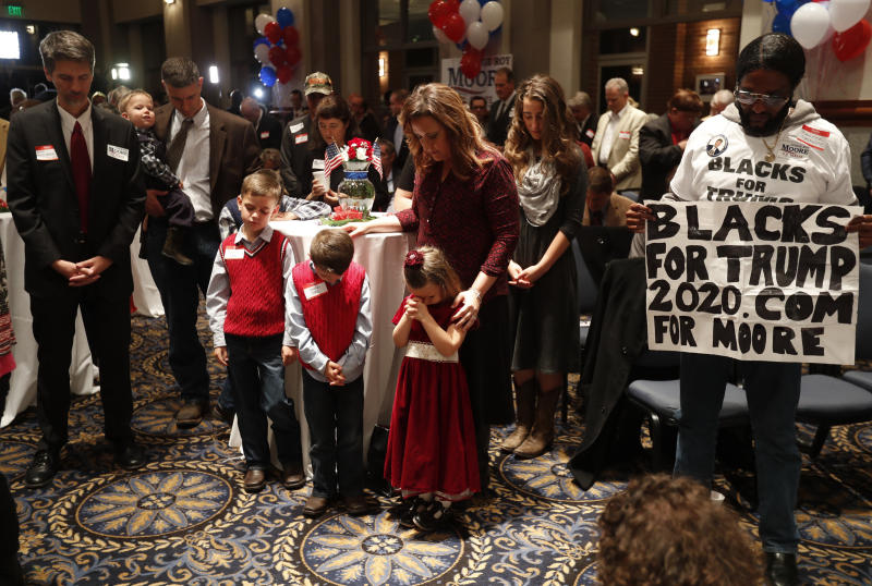 Supporters pray Tuesday during the invocation at Republican U.S. Senate candidate Roy Moore's election night party in Montgomery, Alabama. (Carlo Allegri / Reuters)