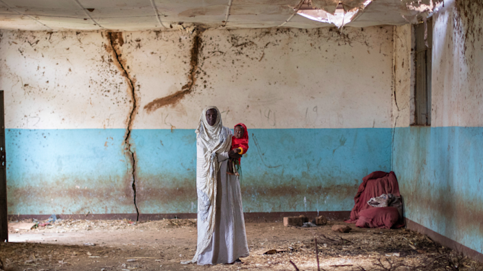 Sahra and her granddaughter in an old building at the site of Hartisheik refugee camp in Ethiopia