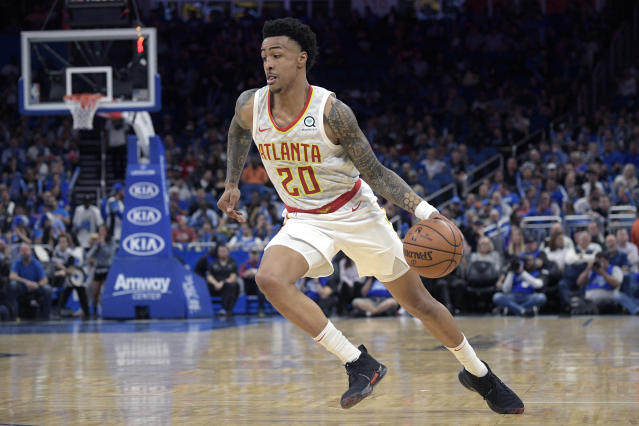 "<a class=""link rapid-noclick-resp"" href=""/nba/players/5832/"" data-ylk=""slk:John Collins"">John Collins</a> will miss the next 25 games due to a suspension. (AP Photo/Phelan M. Ebenhack)"