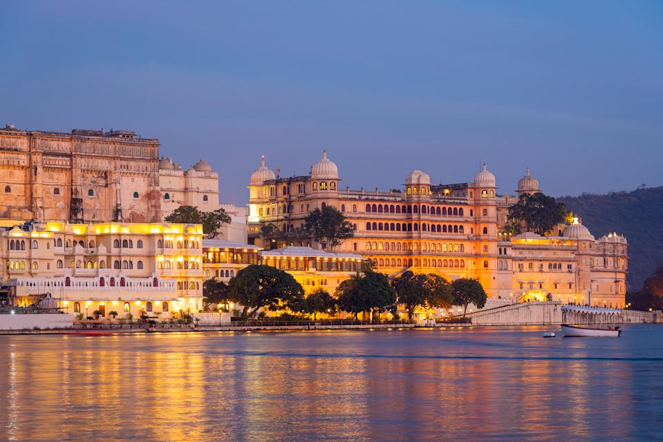 Udaipur city palace and Lake Pichola in Twilight.