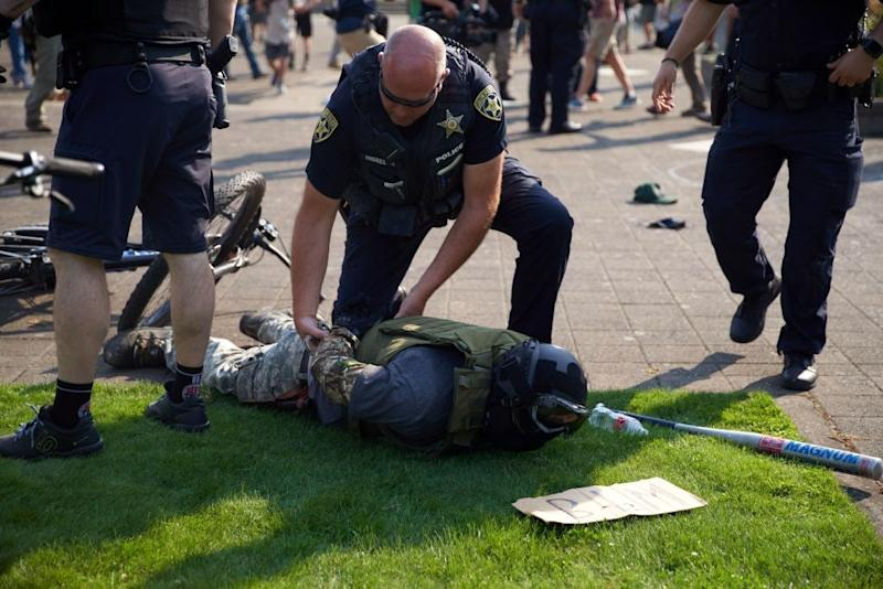 Organised groups of right-wing counter-protesters have begun confronting Black Lives Matter protesters this summer, intensifying violence at clashes in some US cities. (AFP via Getty Images)
