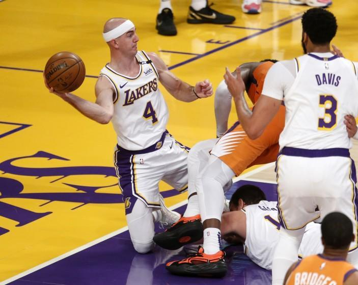 LOS ANGELES, CA - MAY 30: Los Angeles Lakers guard Alex Caruso (4) scrambles for a loose ball in a game against the Phoenix Suns in the second quarter at the Staples Center on Sunday, May 30, 2021 in Los Angeles, CA. Game four of the NBA Western Conference first-round playoff series. (Gary Coronado / Los Angeles Times)