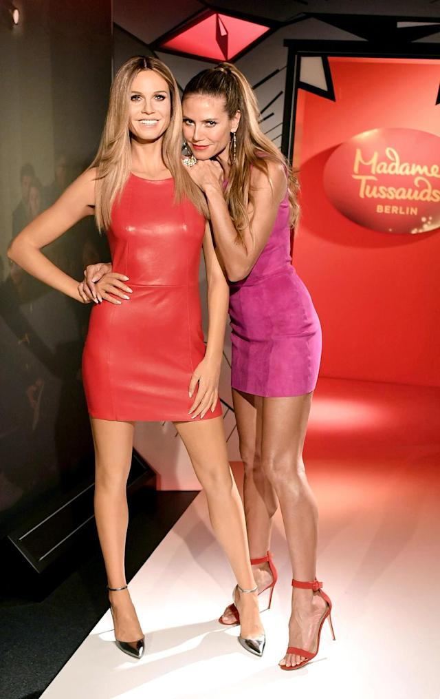 "<p>Double trouble! Heidi Klum leaned on her new wax figurine, which replaced one that was created over eight years ago at Madame Tussauds Berlin. ""I'm also getting older — thank you for renewing me!"" the supermodel cracked at the unveiling. ""The hair color is just perfect."" (Photo: BackGrid) </p>"