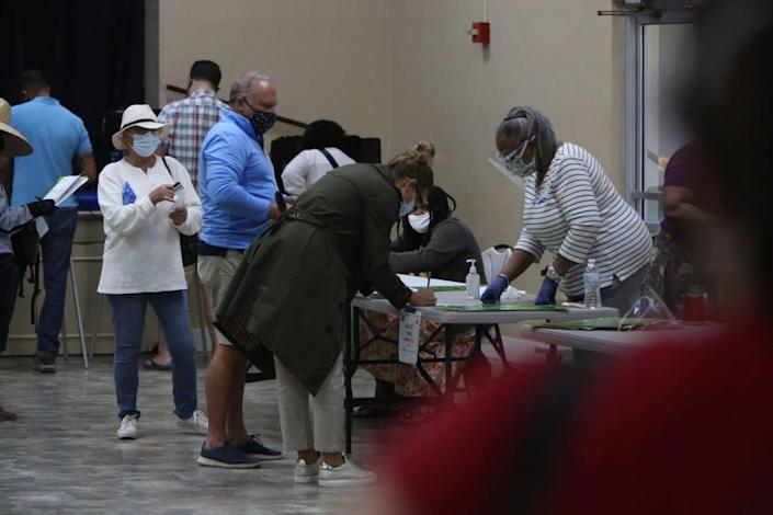 Approximately 50 voters waited in line during a brief flurry of activity as doors opened at 7 a.m. Tuesday, Nov. 3, 2020,  at the C . Lawton McCall Community Center in Miami Shores. They flowed in and right out again after casting their votes and by 7:37 a.m. there was no longer a line.