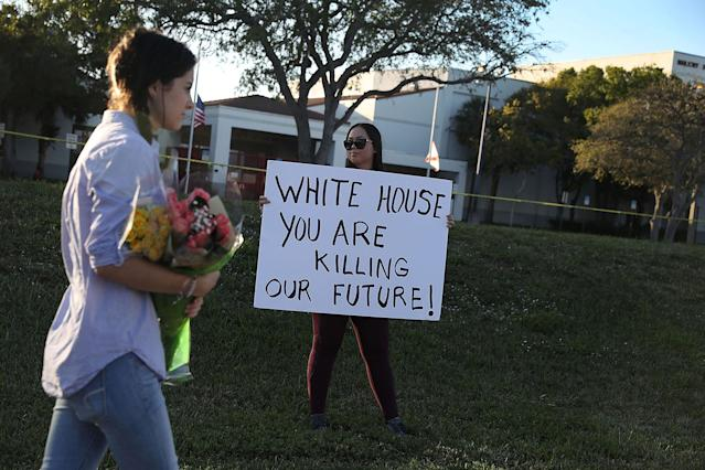 <p>Karissa Saenz, a senior at Marjory Stoneman Douglas High School, holds a sign that reads, ' White House You are Killing Our Future!,' on February 18, 2018 in Parkland, Fla. (Photo: Joe Raedle/Getty Images) </p>