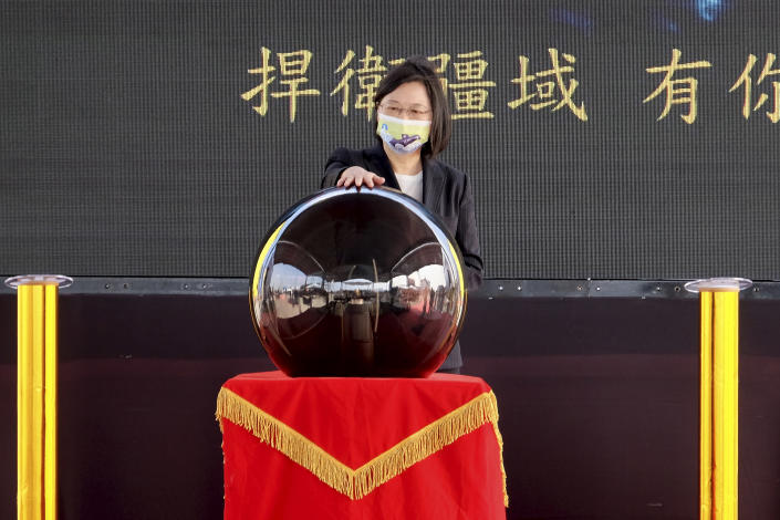 Taiwan's President Tsai Ing-wen touches a ceremonial orb to inaugurate the production of domestically-made submarines at CSBC Corp's shipyards in the southern city of Kaohsiung, Taiwan on Tuesday, Nov. 24, 2020. The move marks a step forward for the island's defense strategy at a time of elevated tensions with China. (AP Photo/Huizhong Wu)