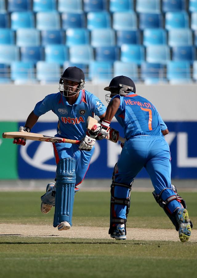 DUBAI, UNITED ARAB EMIRATES - FEBRUARY 15: Ankus Bains and Akhil Herwadkar of India cross for a single during the ICC U19 Cricket World Cup 2014 match between India and Pakistan at the Dubai Sports City Cricket Stadium on February 15, 2014 in Dubai, United Arab Emirates. (Photo by Francois Nel - IDI/IDI via Getty Images)