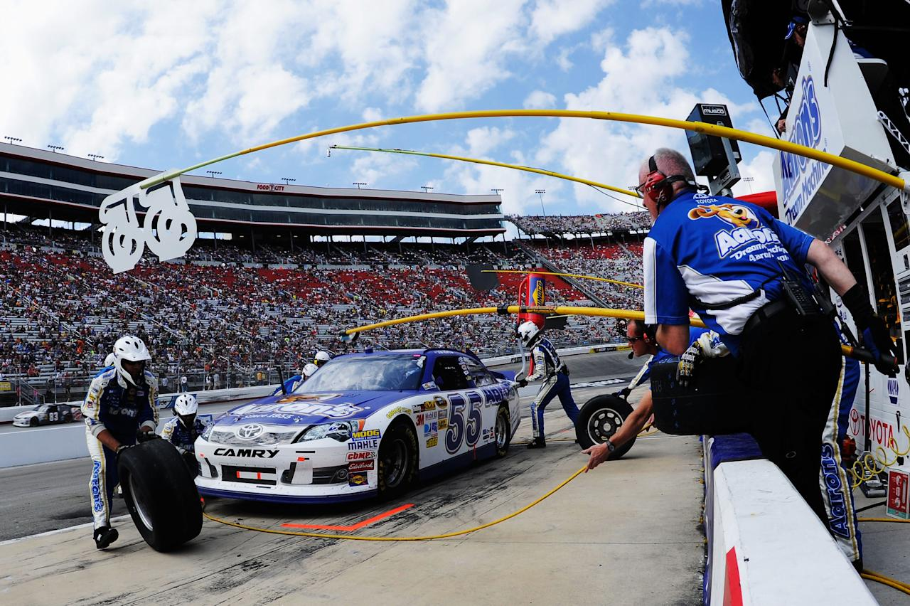 BRISTOL, TN - MARCH 18:  Brian Vickers, driver of the #55 Aaron's Dream Machine Toyota, pits during the NASCAR Sprint Cup Series Food City 500 at Bristol Motor Speedway on March 18, 2012 in Bristol, Tennessee.  (Photo by John Harrelson/Getty Images for NASCAR)