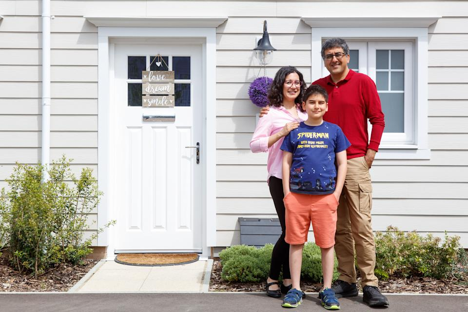 Eda and Yilmaz Bilgen with their son Baris outside their new home at Green Park Village in Reading (ES H&P)