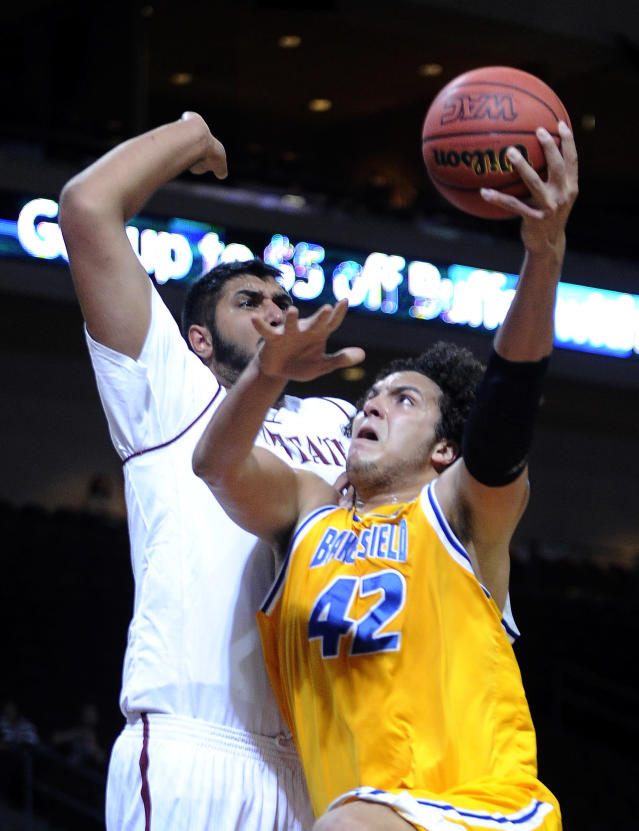 Cal State Bakersfield's Aly Ahmed (42) shoots against New Mexico State's Sim Bhullar during the first half of an NCAA college basketball game in the semifinals of the West Athletic Conferencemen's tournament Friday, March 14, 2014, in Las Vegas. (AP Photo/David Becker)