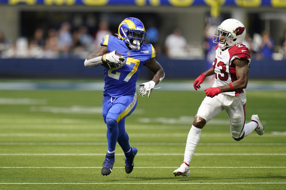 Los Angeles Rams running back Darrell Henderson (27) carries past Arizona Cardinals cornerback Robert Alford (23) during the first half in an NFL football game Sunday, Oct. 3, 2021, in Inglewood, Calif. (AP Photo/Jae C. Hong)
