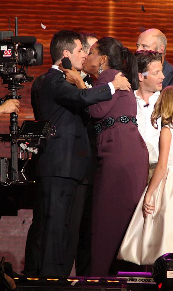"Simon Cowell shared a juicy smooch with Oprah on stage. Barry Brecheisen/<a href=""http://www.wireimage.com"" target=""new"">WireImage.com</a> - May 17, 2011"