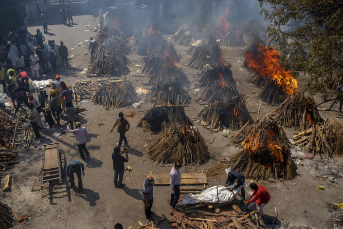 Multiple funeral pyres of victims of COVID-19 burn at a ground that has been converted into a crematorium for mass cremation in New Delhi, India, Saturday, April 24, 2021. Indian authorities are scrambling to get medical oxygen to hospitals where COVID-19 patients are suffocating from low supplies. The effort Saturday comes as the country with the world's worst coronavirus surge set a new global daily record of infections for the third straight day. The 346,786 infections over the past day brought India's total past 16 million. (AP Photo/Altaf Qadri)