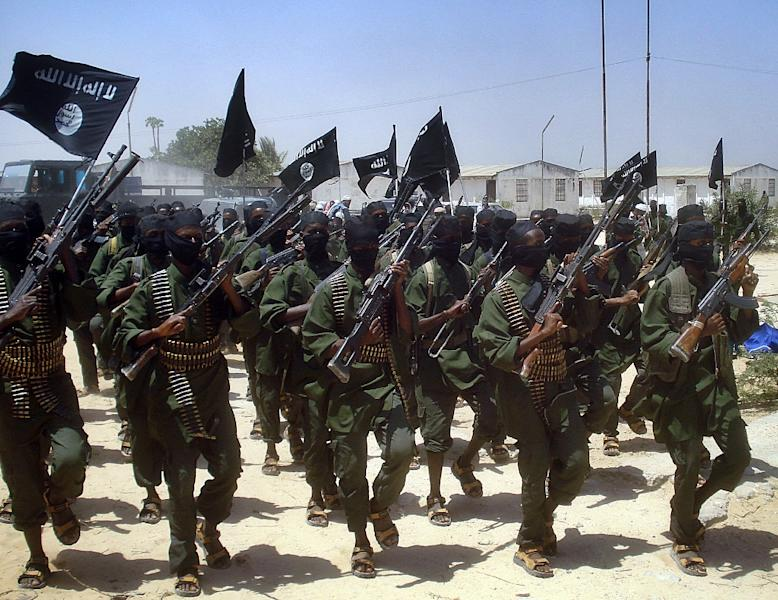Islamist fighters loyal to Somalia's Shebab group perform military drills at a village in Lower Shabelle region, outside Mogadishu (AFP Photo/Mustafa Abdi)