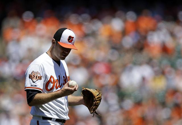 Baltimore Orioles starting pitcher Chris Tillman pauses in the first inning of a baseball game against the Houston Astros, Sunday, May 11, 2014, in Baltimore. Houston scored three runs on Tillman in the first. (AP Photo/Patrick Semansky)