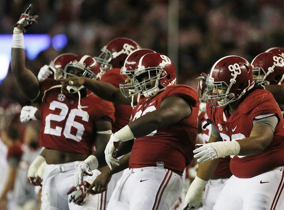 Alabama players celebrate in the closing seconds of the Iron Bowl. (AP)