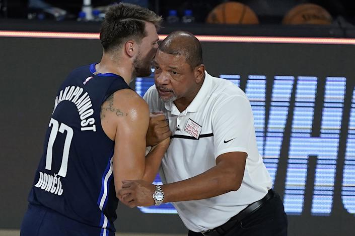 "Dallas Mavericks star Luka Doncic speaks to Clippers coach Doc Rivers after a game on Thursday. <span class=""copyright"">(Ashley Landis / Getty Images)</span>"