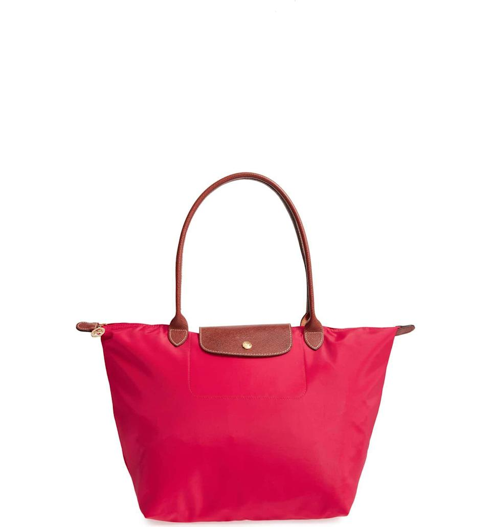 """<p><strong>LONGCHAMP</strong></p><p>nordstrom.com</p><p><strong>$145.00</strong></p><p><a href=""""https://go.redirectingat.com?id=74968X1596630&url=https%3A%2F%2Fshop.nordstrom.com%2Fs%2Flongchamp-large-le-pliage-tote%2F3241956&sref=https%3A%2F%2Fwww.townandcountrymag.com%2Fleisure%2Fg26946158%2Fbest-nanny-gifts%2F"""" rel=""""nofollow noopener"""" target=""""_blank"""" data-ylk=""""slk:Shop Now"""" class=""""link rapid-noclick-resp"""">Shop Now</a></p><p>Between the kids stuff and her own, your nanny has plenty to carry. Help her do it in style with this fan-favorite Longchamp tote. </p>"""