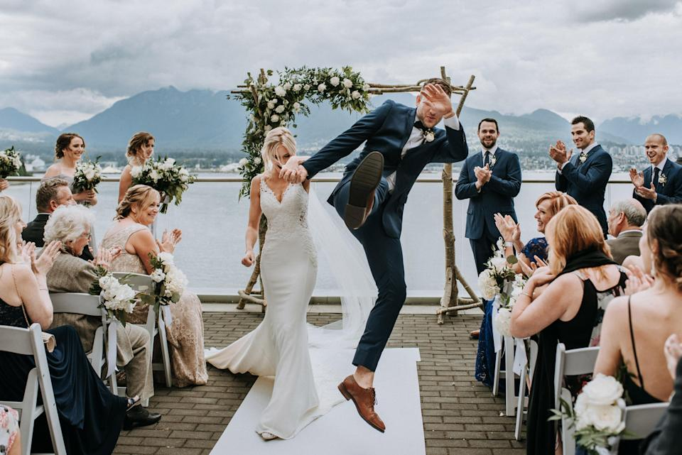 <p>A groom jumps for joy as he walks down the aisle with his new wife. <em>[<span>SARA ROGERS PHOTOGRAPHY / JUNEBUG WEDDINGS / CATERS]</span></em> </p>