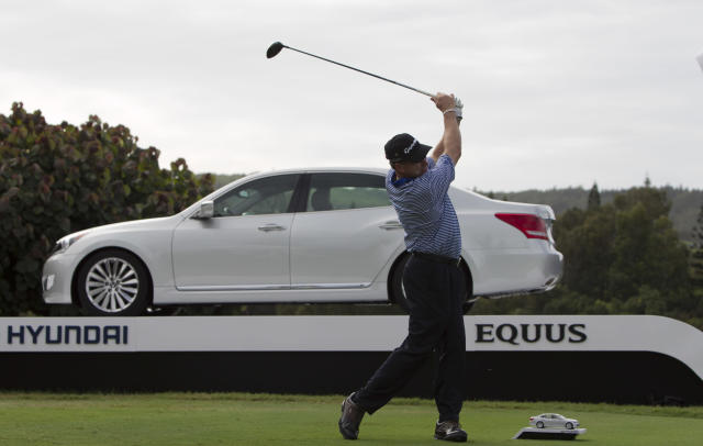 Woody Austin tees off on the first hold during the first round of Tournament of Champions golf tournament, Friday, Jan. 3, 2014, in Kapalua, Hawaii. (AP Photo/Marco Garcia)