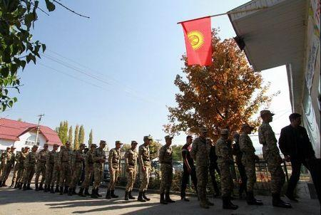 Soldiers queue to enter a polling station during the presidential election in the village of Kyzyl-Birdik, Kyrgyzstan October 15, 2017.  REUTERS/Vladimir Pirogov